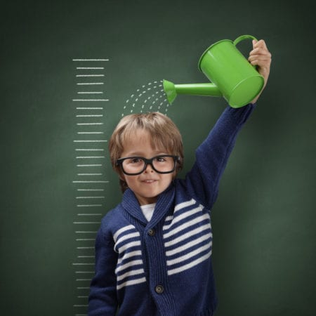 boy growing himself with watering can