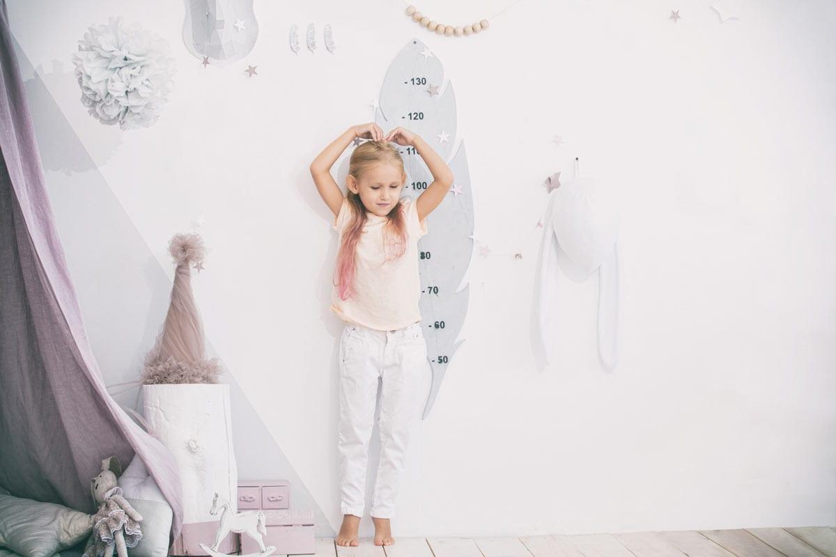 little girl measuring herself